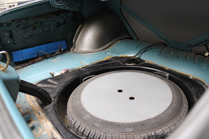 Spare wheel, inserted in fuel tank